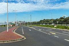Asphalt Tarred Road and Green Vegetation Against City Skyline. In Durban, South Africa Stock Image