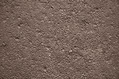 Asphalt texture. Abstract background: asphalt surface texture with sunlight and shadow pattern. Landscape orientation. CAn be used as a wallpaper Stock Photography