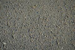Asphalt texture with black tar, black grey background. A cross section from the ground from the highway royalty free stock photography