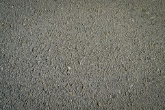 Asphalt texture with black tar, black grey background. A cross section from the ground from the highway stock photography