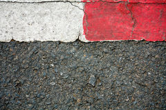 Asphalt texture. With red and white line marking Stock Images