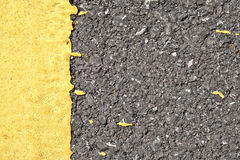 Asphalt texture with yellow border Royalty Free Stock Photo