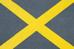Asphalt texture with yellow cross Stock Photos