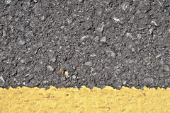 Asphalt texture with yellow line Royalty Free Stock Photography