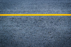 Asphalt texture with yellow line Stock Photos
