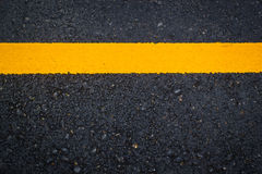 Asphalt texture with yellow line Royalty Free Stock Image