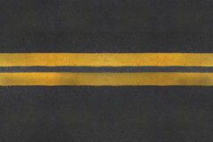 Asphalt texture with yellow line Royalty Free Stock Photo