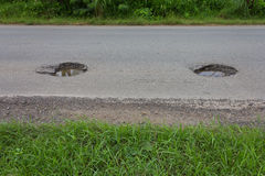 Asphalt was damaged and dangerous potholes. Stock Photos