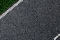 The asphalt which is smoothly passing to a white border and a green grass.  Royalty Free Stock Photos