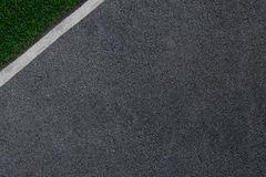The asphalt which is smoothly passing to a white border and a green grass.  Royalty Free Stock Photography