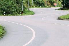 Asphalt Winding Road stock afbeeldingen