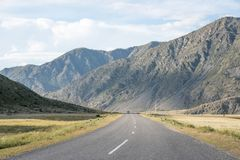 Asphalt winding road in the mountainous area in the summer and s Royalty Free Stock Images