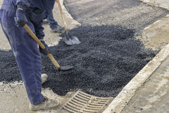 Asphalt workers with shovels patching asphalt 2 Royalty Free Stock Images