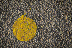 Asphalt with yellow paint dot road close up Stock Photography