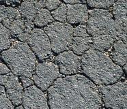 Asphalte noir fissuré Photo libre de droits