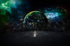 Asphalted highway over night sky with earth stars background. El Stock Image