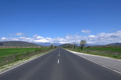 Asphalted road and the blue sky Stock Photo