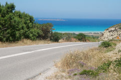 Asphalted road. Road leading to the sea Royalty Free Stock Images