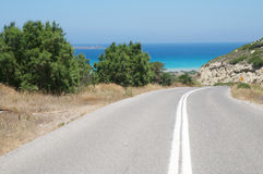 Asphalted road. Road leading to the sea Royalty Free Stock Image