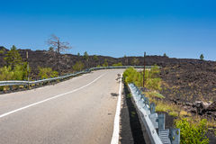 Asphalted road in a mountains near Etna Royalty Free Stock Photography