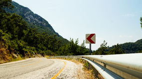 The asphalted road passing in the mountains. Photo Stock Photo