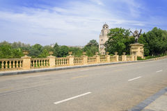 Asphalted road with stone balustrade in sunny autumn Stock Image