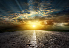 Asphalted road at sunset. Royalty Free Stock Photos