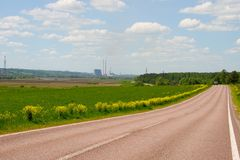 Asphalted road to a countryside. stock photos