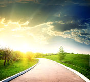 Asphalted road to the sun Stock Photos