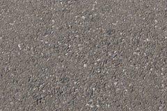 Asphaltgrau mit Steinschlägen Beschaffenheit Stockfoto