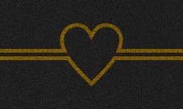 Asphalthintergrund mit gemaltem Herzen Stockfotos