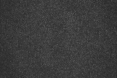 Asphalthintergrundbeschaffenheit mit einigem Fein lizenzfreie stockfotos