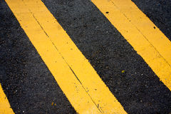 Asphaltic concrete road background and traffic sign Stock Photos
