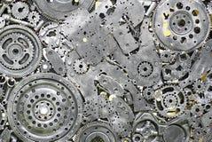 Asphaltieren Sie Gänge, Auto, Auto, motocycle Handwerksmetallgrafik von benutzten Ersatzteilen Lizenzfreies Stockbild