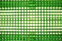 asphaltieren Sie Masche mit einem quadratischen Muster auf einer hellen Lampe mit Steigungseffekt Lizenzfreies Stockfoto