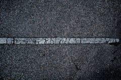 Asphaltieren Sie Oberfläche der Straße mit Linien abstrakter Hintergrund Stockfoto