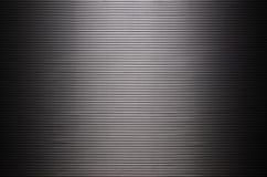 Asphaltieren Sie Wand mit unsichtbaren Lichtquellen, die das midd belichten Stockfotografie