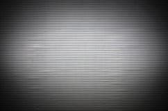 Asphaltieren Sie Wand mit unsichtbaren Lichtquellen, die das midd belichten Lizenzfreies Stockbild