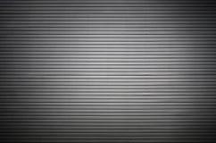 Asphaltieren Sie Wand mit unsichtbaren Lichtquellen, die das midd belichten Lizenzfreie Stockfotografie