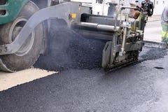 Asphalting. Asphalt machine for road works Royalty Free Stock Images