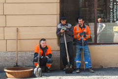 Asphalting, group workers with shovels Stock Photography