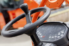 Asphalting machine- steering wheel and dashboard Royalty Free Stock Photo