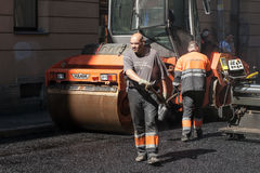 Asphalting in progress with workers and asphalter Royalty Free Stock Photo