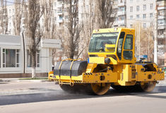 Asphalting of roads in the city Stock Photos