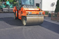 Asphalting roads Stock Images
