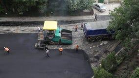 Asphalting team, timelapse under construction. Asphalting team, time lapse under construction stock footage