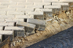 Asphalting of territory at a trading-office complex with the dismantling of paving slabs, which was laid before. Stock Photography