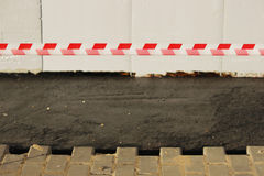 Asphalting of territory at a trading-office complex with the dismantling of paving slabs, which was laid before. Royalty Free Stock Images