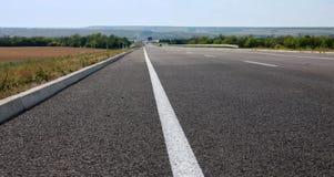 Asphaltstraße für schnell fahren Stockbild