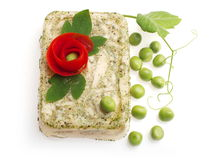 Aspic from bird decorated with tomato flower... Aspic from bird decorated with tomato flower and green pea over white background Royalty Free Stock Photos